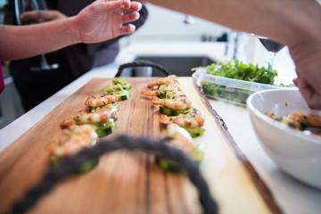 Fotobehang Sushi bar Prepping shrimp in kitchen