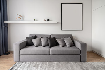 Stylish modern interior with white walls and parquet with carpet Fototapete