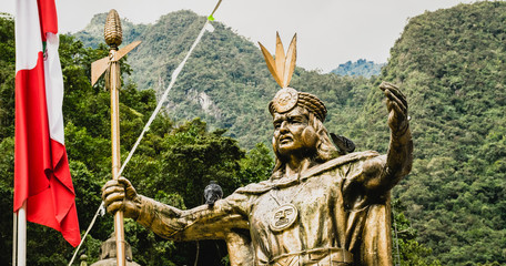 Aguas Calientes, Peru - 05/21/2019: Statues of Inca Emperor Pachacuti in Aguas Calientes square in Peru outside Machu Picchu.