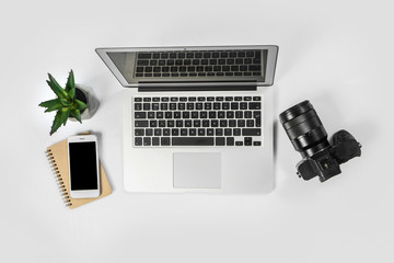 Comfortable workplace of photographer with laptop on white background
