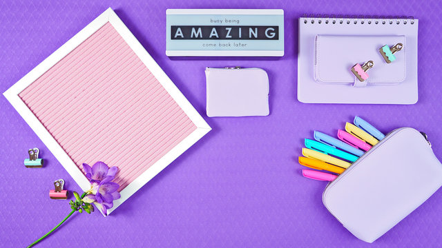 Back to school purple teen's theme concept flat lay with pink notice board, stationery and accessories.