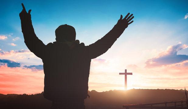 Religious concept: christian worship on cross sunrise background