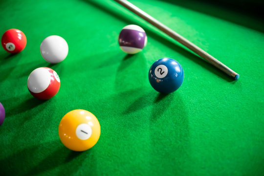 close up of snooker or billiard game on a table.