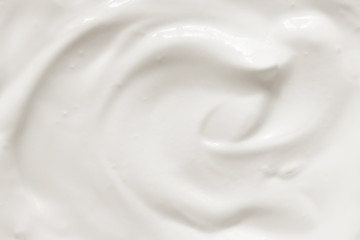 Cream, yogurt texture. White dairy food background.