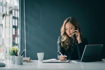 Fototapeta Portrait of beautiful smiling young  entrepreneur businesswoman working in modern work station. obraz