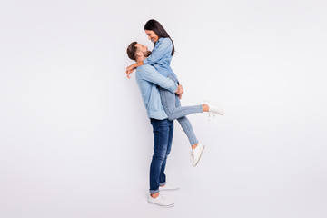 Full length profile side photo of cheerful lady and guy cuddling smiling wearing denim jeans...