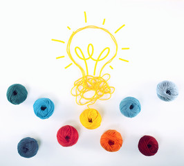 Fototapete - Concept of idea and innovation with wool ball that shapes a lightbulb