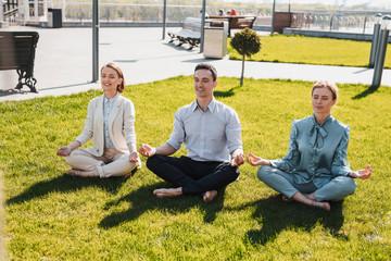 People restoring their energy meditating in the park