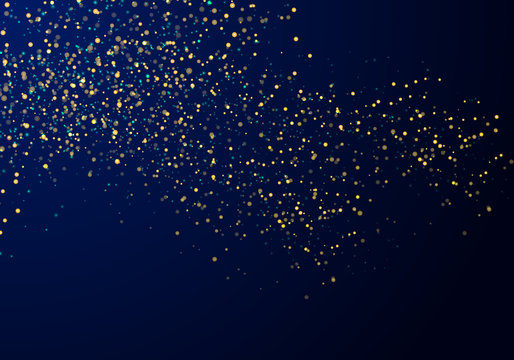 Abstract falling particles golden glitter lights texture on a dark blue background with lighting.