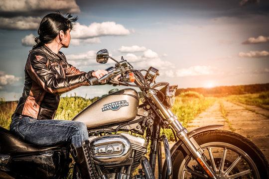 Biker girl and bike Harley Sportster
