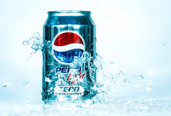 Can of Pepsi cola Lignt in water.