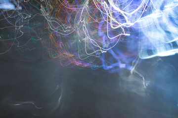 Vivid, tangled streaks of light. Poznan,  city night blurred lights, drugs like perceptions. Background.