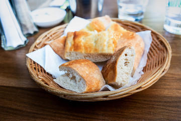 Fototapete - bread in basket - little roll breads in basket on table