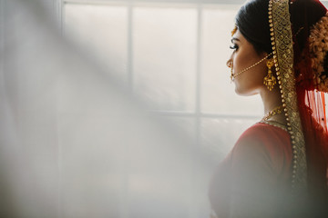 Young Indian bride looks out the window Wall mural