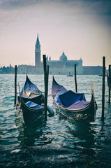 Gondola boats on canals in Venice Italy