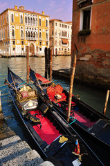 Gondola boats on a canal in Venice Italy