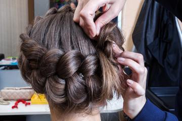 weaving braids woman