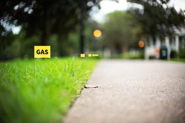 Gas line stake flag buried underground utility