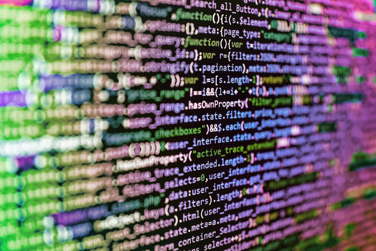 Programming code abstract screen of software developer. Business Corporate Word Search Puzzle. Website Coding. Website HTML Code on the Laptop Display Closeup Photo
