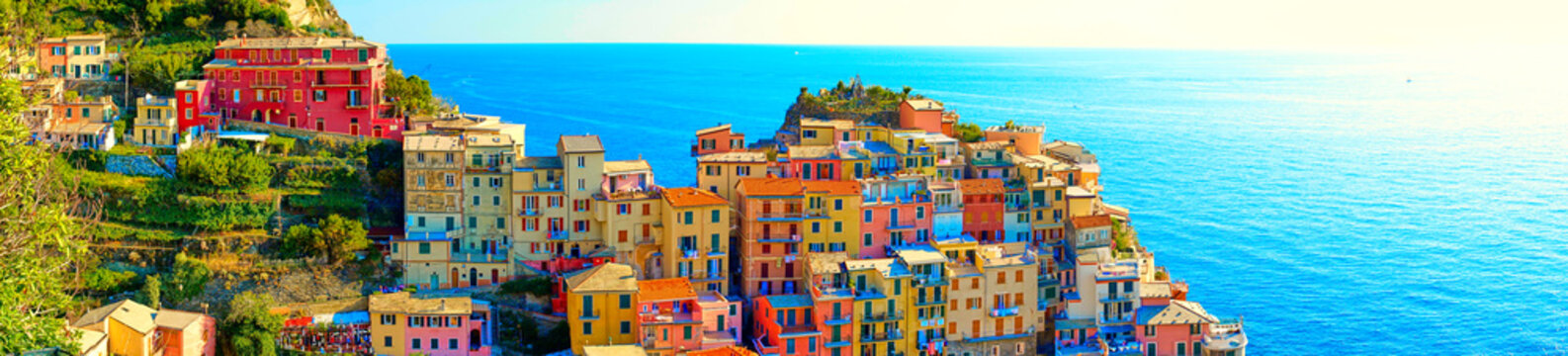 "Colorful houses of Manarola, a beautiful village in ""Cinque Terre National Park"". Stunning scenery at coast of Italy. Fishermen village in the province of La Spezia, Liguria, Italy"
