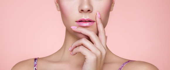 Beauty Woman with perfect Makeup and Manicure. Pink Lips and Nails. Beauty girls Face isolated on light Background. Fashion photo
