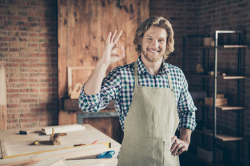 Portrait of his he nice attractive handsome cheerful cheery guy small business shop owner showing ok-sign recommend at industrial brick loft style interior indoors workplace
