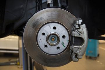 The braking system of a modern car. Brake Disc. Brake Caliper. Close-up.
