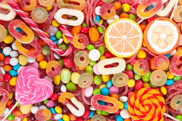 Wall Mural - Colorful lollipops and different colored candies.