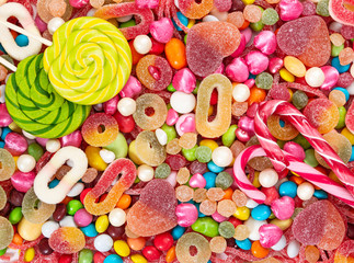 Fototapete - Colorful lollipops and different colored candies.