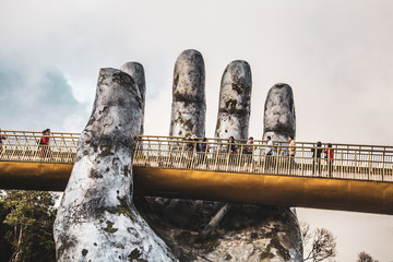 Golden bridge in Bana Hills French village, Sun World, Da Nang, Central Vietnam