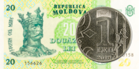 1 moldovan leu coin against 20 moldovan banknote indicating growing economics with copyspace