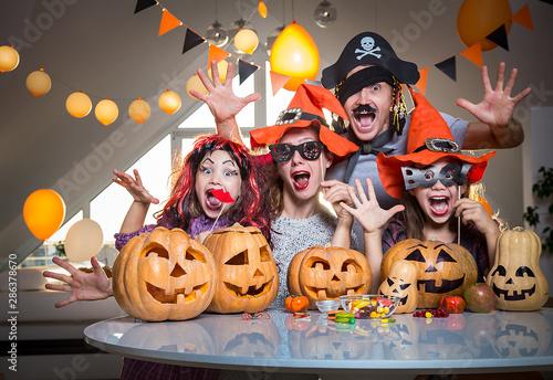 family celebrates halloween
