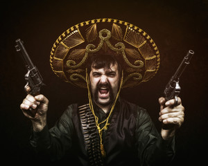 Classic Mexican style bandito with two revolver handguns. sombrero, and a bandolier.