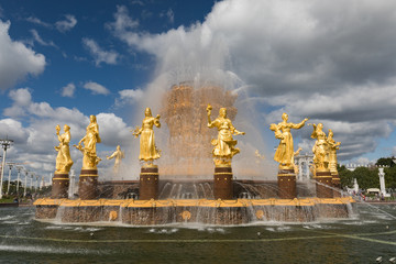 The Peoples Friendship Fountain in VDNKh park in Moscow. Amazing sunny view of the Soviet architecture, landmark of Moscow. Beautiful luxurious old fountain in summer.