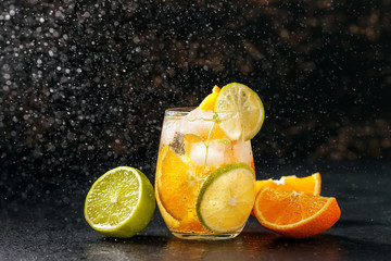 Cocktail with orange, lime and ice