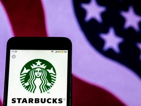 Kiev, Ukraine, December 16, 2018, illustrative editorial. Starbucks Coffee company logo seen displayed on smart phone.