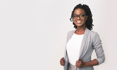 African American Business Girl Smiling At Camera, Studio Shot