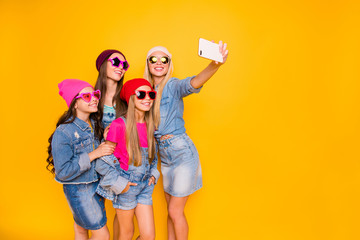 Full body photo of pretty cute stylish trendy blonde brunette models in denim outfit having good day teen ladies taking picture on holidays vacation for instagram isolated yellow background