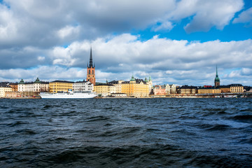 Wall Mural - View of Gamla Stan in Stockholm, Sweden with landmarks like Riddarholm Church during the cloudy and sunny day