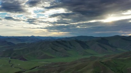 Wall Mural - Aerial panorama landscape with the setting sun in the mountains of Mongolia, 4k