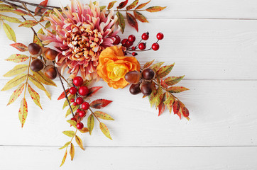 autumn leaves and fruits on wooden background Wall mural
