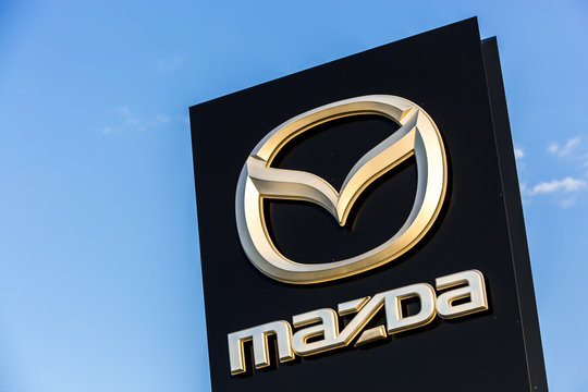 La rochelle, France - August 30, 2016: Official dealership sign of Mazda against the blue sky. Mazda Corporation is a Japanese automotive manufacturer