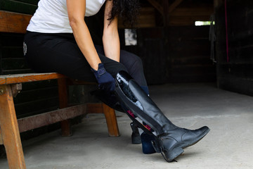 Equestrian sport. Leather equestrian boots. Riding clothes.