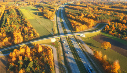 Foto op Canvas Meloen Drone view of highway in autumn scenery