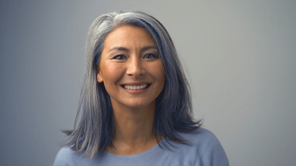 Good-looking Middle-Aged Woman Is Smiling Cheerfully