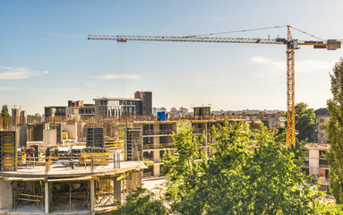 View of the construction of a high-rise apartment building in the center of Kiev, Ukraine. With the help of tower cranes, concrete work is carried out on the fifth floor.