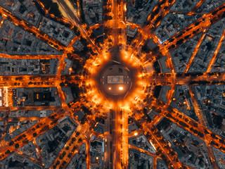 Aerial of the Arc de Triomphe in Paris, France at night