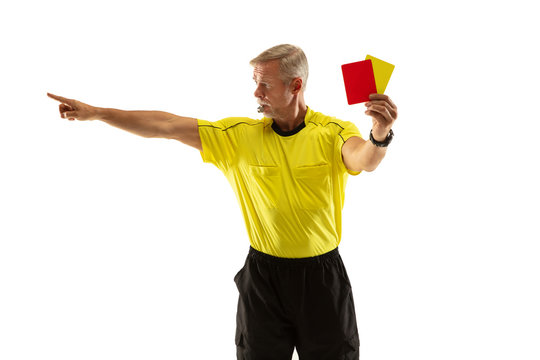 Referee showing a red and yellow cards to a football or soccer player while gaming on white studio background. Concept of sport, rules violation, controversial issues, obstacles overcoming.
