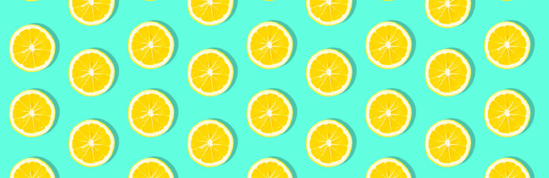 Fresh lemon (lemons) pattern on pink background. Minimal concept. Summer minimal concept. Flat lay