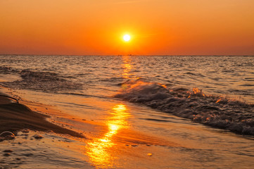 Sunset - sun reflecting in sea/ ocean, shore